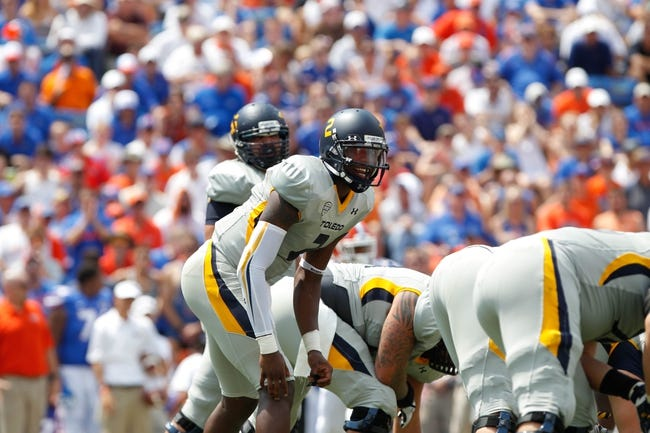 Aug 31, 2013; Gainesville, FL, USA; Toledo Rockets quarterback Terrance Owens (2) calls a play against the Florida Gators during the second half at Ben Hill Griffin Stadium. Florida Gators defeated the Toledo Rockets 24-6. Mandatory Credit: Kim Klement-USA TODAY Sports