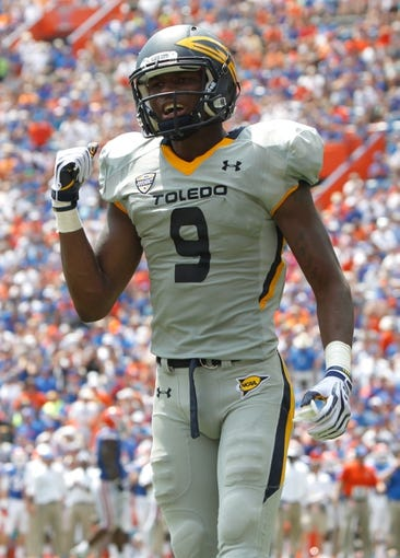 Aug 31, 2013; Gainesville, FL, USA; Toledo Rockets wide receiver Alonzo Russell (9) during the second half against the Florida Gators at Ben Hill Griffin Stadium. Florida Gators defeated the Toledo Rockets 24-6. Mandatory Credit: Kim Klement-USA TODAY Sports