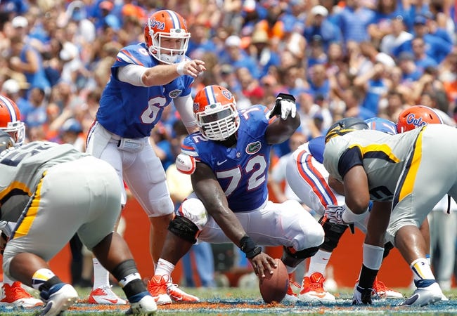 Aug 31, 2013; Gainesville, FL, USA; Florida Gators quarterback Jeff Driskel (6) and Florida Gators offensive linesman Jonotthan Harrison (72) point before the ball is hiked against the Toledo Rockets during the first half at Ben Hill Griffin Stadium. Mandatory Credit: Kim Klement-USA TODAY Sports