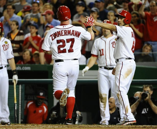 Sep 20, 2013; Washington, DC, USA; Washington Nationals starting pitcher Jordan Zimmermann (27) is congratulated by second baseman Anthony Rendon (6) after scoring a run against the Miami Marlins during the sixth inning at Nationals Park. Mandatory Credit: Brad Mills-USA TODAY Sports