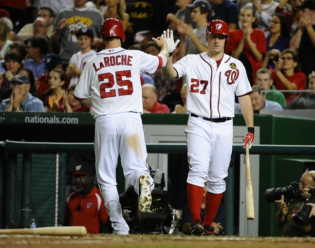 Sep 20, 2013; Washington, DC, USA; Washington Nationals first baseman Adam LaRoche (25) is congratulated by starting pitcher Jordan Zimmermann (27) after scoring a run against the Miami Marlins  during the sixth inning at Nationals Park. Mandatory Credit: Brad Mills-USA TODAY Sports