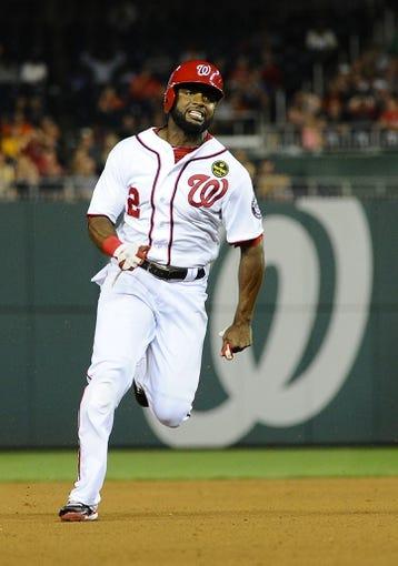 Sep 20, 2013; Washington, DC, USA; Washington Nationals center fielder Denard Span (2) runs to third base against the Miami Marlins during the sixth inning at Nationals Park. Mandatory Credit: Brad Mills-USA TODAY Sports