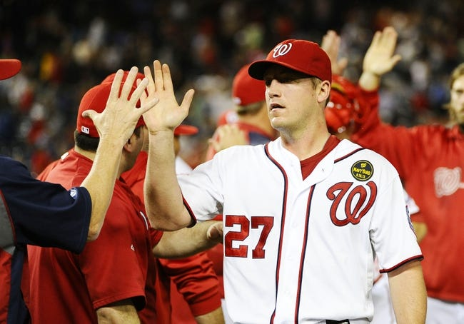 Sep 20, 2013; Washington, DC, USA; Washington Nationals starting pitcher Jordan Zimmermann (27) is congratulated by teammates after defeating the Miami Marlins at Nationals Park. Mandatory Credit: Brad Mills-USA TODAY Sports