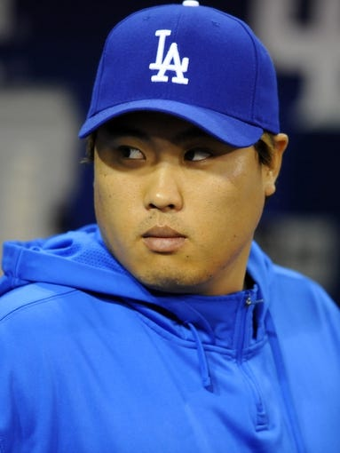 Sep 20, 2013; San Diego, CA, USA; Los Angeles Dodgers starting pitcher Hyun-Jin Ryu (99) prior to the game against the San Diego Padres at Petco Park. Mandatory Credit: Christopher Hanewinckel-USA TODAY Sports