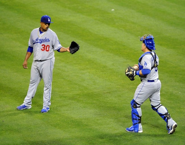 Sep 20, 2013; San Diego, CA, USA; Los Angeles Dodgers starting pitcher Edinson Volquez (30) and catcher Tim Federowicz (18) talk after a walk during the third inning against the San Diego Padres at Petco Park. Mandatory Credit: Christopher Hanewinckel-USA TODAY Sports