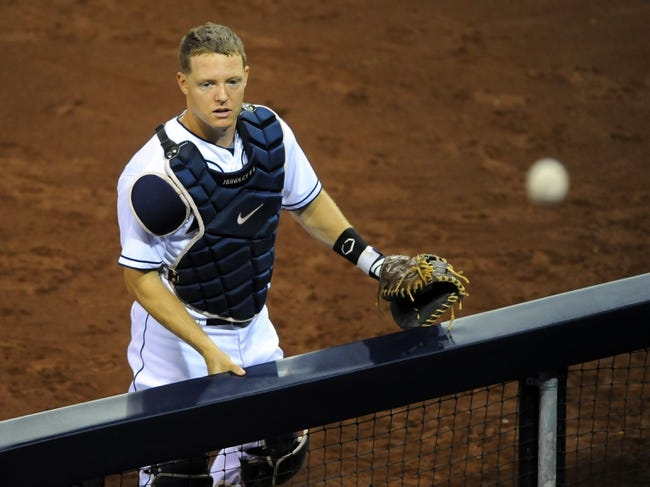 Sep 20, 2013; San Diego, CA, USA; San Diego Padres catcher Nick Hundley (4) watches a foul ball go out of play during the fourth inning against the Los Angeles Dodgers at Petco Park. Mandatory Credit: Christopher Hanewinckel-USA TODAY Sports