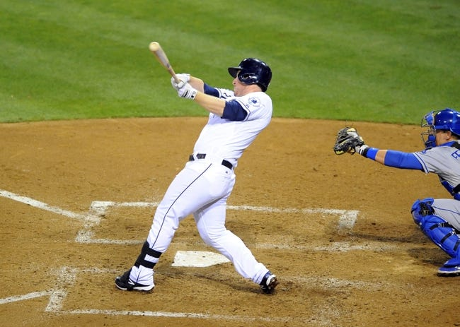Sep 20, 2013; San Diego, CA, USA; San Diego Padres second baseman Jedd Gyorko (9) hits a solo home run during the fifth inning against the Los Angeles Dodgers at Petco Park. Mandatory Credit: Christopher Hanewinckel-USA TODAY Sports