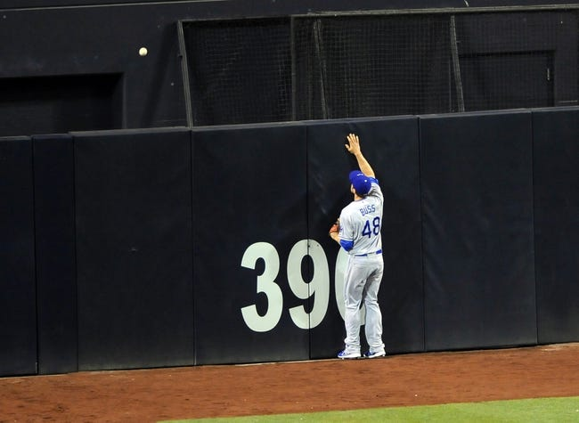 Sep 20, 2013; San Diego, CA, USA; Los Angeles Dodgers center fielder Nick Buss (48) watches a solo home run hit by San Diego Padres second baseman Jedd Gyorko (not pictured) during the fifth inning at Petco Park. Mandatory Credit: Christopher Hanewinckel-USA TODAY Sports