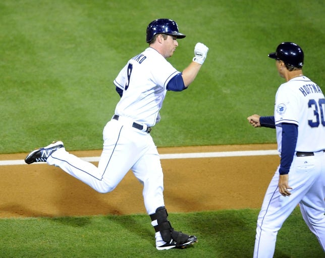 Sep 20, 2013; San Diego, CA, USA; San Diego Padres second baseman Jedd Gyorko (9) is congratulated by third base coach Glenn Hoffman (30) after a solo home run during the fifth inning against the Los Angeles Dodgers at Petco Park. Mandatory Credit: Christopher Hanewinckel-USA TODAY Sports