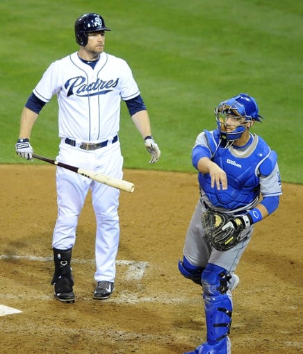 Sep 20, 2013; San Diego, CA, USA; San Diego Padres third baseman Chase Headley (7) reacts after a called strike three during the fifth inning against the Los Angeles Dodgers at Petco Park. Mandatory Credit: Christopher Hanewinckel-USA TODAY Sports