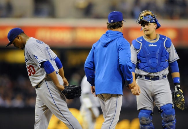 Sep 20, 2013; San Diego, CA, USA; Los Angeles Dodgers starting pitcher Edinson Volquez (30) is taken out of the game by manager Don Mattingly (8) during the seventh inning against the San Diego Padres at Petco Park. Mandatory Credit: Christopher Hanewinckel-USA TODAY Sports