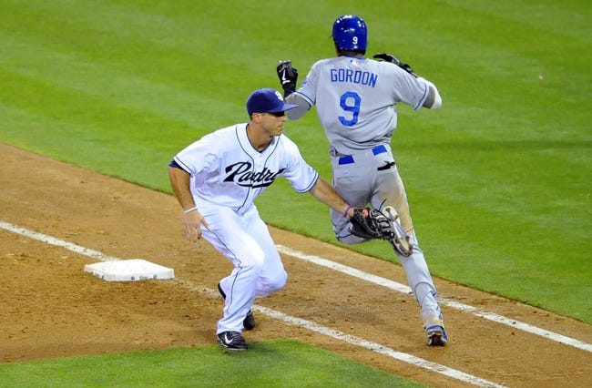 Sep 20, 2013; San Diego, CA, USA; San Diego Padres first baseman Tommy Medica (54) tags out Los Angeles Dodgers shortstop Dee Gordon (9) during the sixth inning at Petco Park. Mandatory Credit: Christopher Hanewinckel-USA TODAY Sports