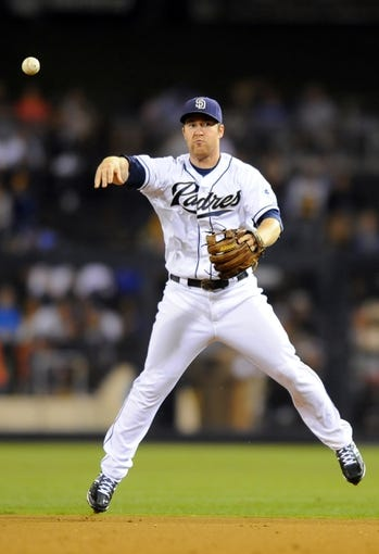 Sep 20, 2013; San Diego, CA, USA; San Diego Padres second baseman Jedd Gyorko (9) throws the ball to first base for an out during the eighth inning against the Los Angeles Dodgers at Petco Park. Mandatory Credit: Christopher Hanewinckel-USA TODAY Sports
