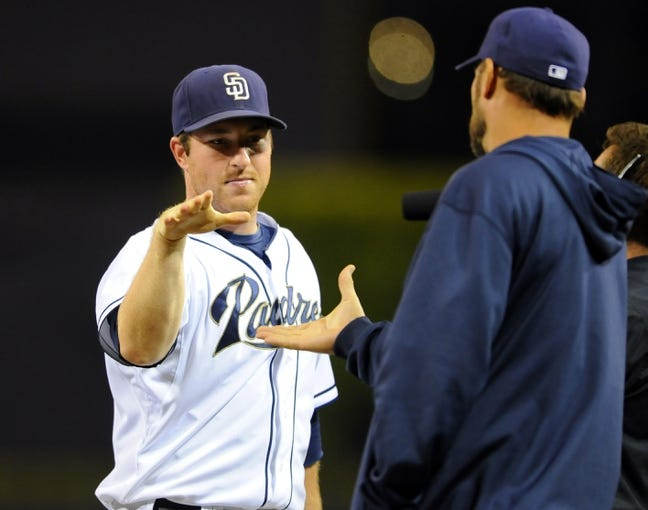 Sep 20, 2013; San Diego, CA, USA; San Diego Padres second baseman Jedd Gyorko (9) is congratulated by Mark Kotsay (14) after a 2-0 win against the Los Angeles Dodgers at Petco Park. Mandatory Credit: Christopher Hanewinckel-USA TODAY Sports