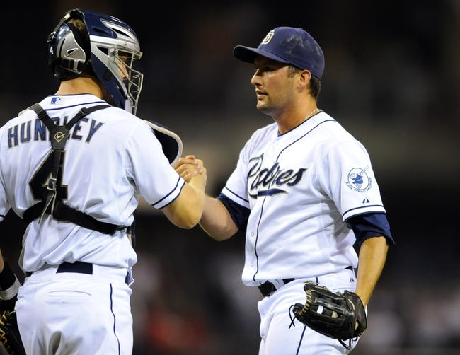 Sep 20, 2013; San Diego, CA, USA; San Diego Padres relief pitcher Huston Street (16) celebrates with catcher Nick Hundley (4) after a 2-0 win against the Los Angeles Dodgers at Petco Park. Mandatory Credit: Christopher Hanewinckel-USA TODAY Sports