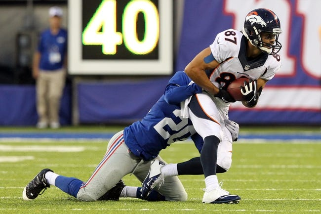 Sep 15, 2013; East Rutherford, NJ, USA; Denver Broncos wide receiver Eric Decker (87) is brought down by New York Giants corner back Prince Amukamara (20) during a game at MetLife Stadium. Mandatory Credit: Brad Penner-USA TODAY Sports