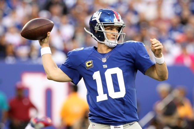 Sep 15, 2013; East Rutherford, NJ, USA; New York Giants quarterback Eli Manning (10) drops back to pass against the Denver Broncos during a game at MetLife Stadium. Mandatory Credit: Brad Penner-USA TODAY Sports