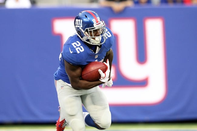 Sep 15, 2013; East Rutherford, NJ, USA; New York Giants running back David Wilson (22) runs with the ball against the Denver Broncos during a game at MetLife Stadium. Mandatory Credit: Brad Penner-USA TODAY Sports