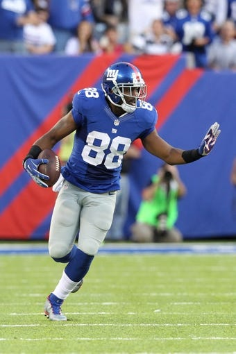 Sep 15, 2013; East Rutherford, NJ, USA; New York Giants wide receiver Hakeem Nicks (88) runs with the ball against the Denver Broncos during a game at MetLife Stadium. Mandatory Credit: Brad Penner-USA TODAY Sports