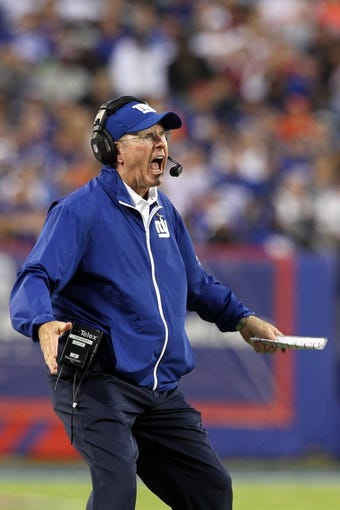 Sep 15, 2013; East Rutherford, NJ, USA; New York Giants head coach Tom Coughlin reacts against the Denver Broncos during a game at MetLife Stadium. Mandatory Credit: Brad Penner-USA TODAY Sports