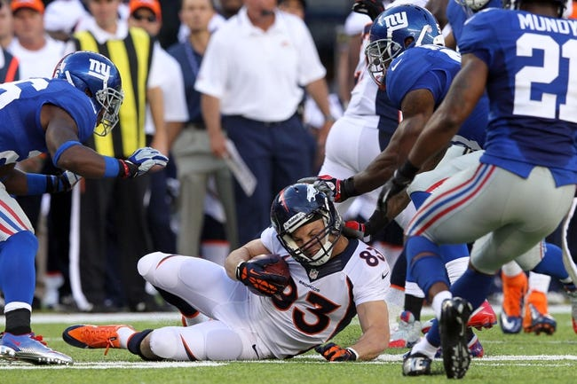 Sep 15, 2013; East Rutherford, NJ, USA; Denver Broncos wide receiver Wes Welker (83) is tackled during a game against the New York Giants during a game at MetLife Stadium. Mandatory Credit: Brad Penner-USA TODAY Sports