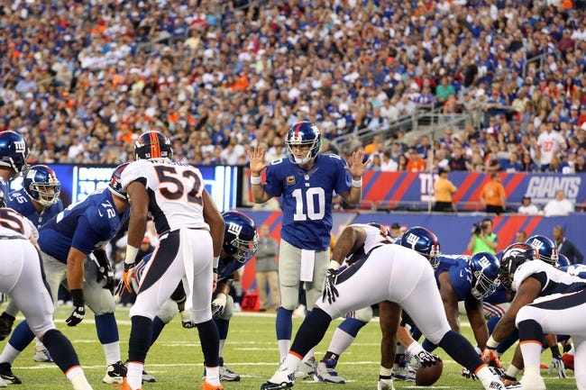 Sep 15, 2013; East Rutherford, NJ, USA; New York Giants quarterback Eli Manning (10) signals at the line during a game against the Denver Broncos at MetLife Stadium. Mandatory Credit: Brad Penner-USA TODAY Sports