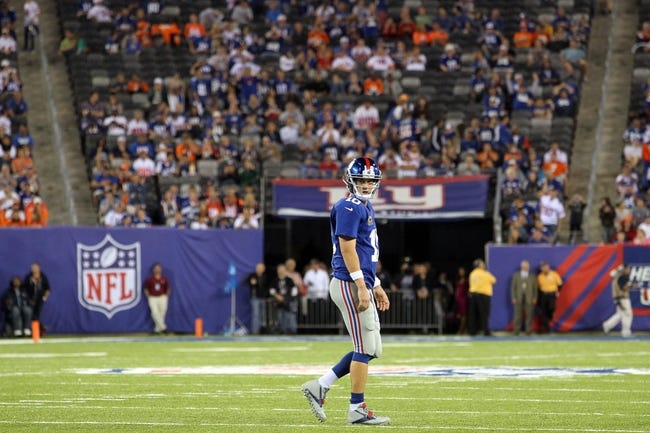 Sep 15, 2013; East Rutherford, NJ, USA; New York Giants quarterback Eli Manning (10) reacts during a game against the Denver Broncos at MetLife Stadium. Mandatory Credit: Brad Penner-USA TODAY Sports