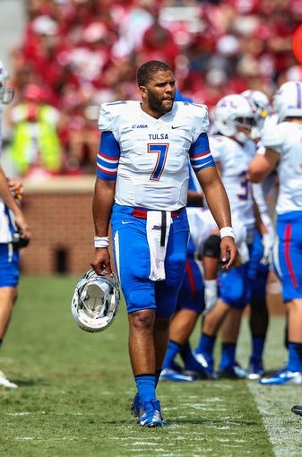 Sep 14, 2013; Norman, OK, USA; Tulsa Golden Hurricane quarterback Cody Green (7) reacts during the game against the Oklahoma Sooners at Gaylord Family - Oklahoma Memorial Stadium. Oklahoma won 51-20. Mandatory Credit: Kevin Jairaj-USA TODAY Sports