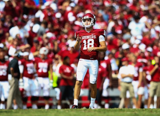 Sep 14, 2013; Norman, OK, USA; Oklahoma Sooners kicker Michael Hunnicutt (18) lines up a field goal during the game against the Tulsa Golden Hurricane at Gaylord Family - Oklahoma Memorial Stadium. Oklahoma won 51-20. Mandatory Credit: Kevin Jairaj-USA TODAY Sports