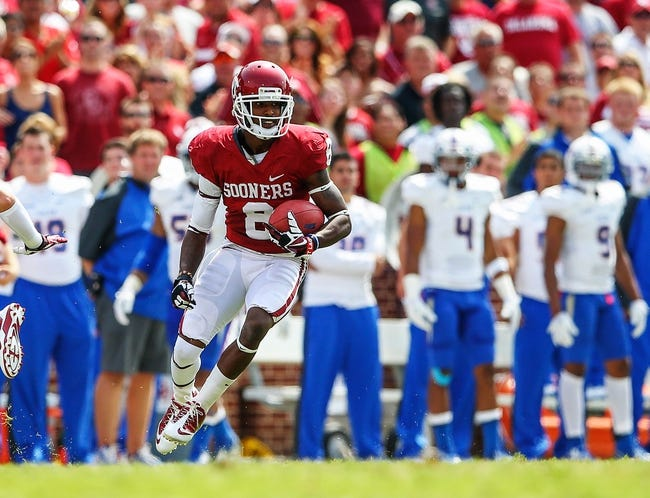 Sep 14, 2013; Norman, OK, USA; Oklahoma Sooners wide receiver Jalen Saunders (8) runs with the ball during the game against the Tulsa Golden Hurricane at Gaylord Family - Oklahoma Memorial Stadium. Oklahoma won 51-20. Mandatory Credit: Kevin Jairaj-USA TODAY Sports