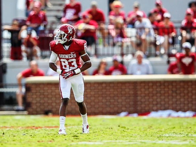 Sep 14, 2013; Norman, OK, USA; Oklahoma Sooners wide receiver Austin Bennett (83) during the game against the Tulsa Golden Hurricane at Gaylord Family - Oklahoma Memorial Stadium. Oklahoma won 51-20. Mandatory Credit: Kevin Jairaj-USA TODAY Sports