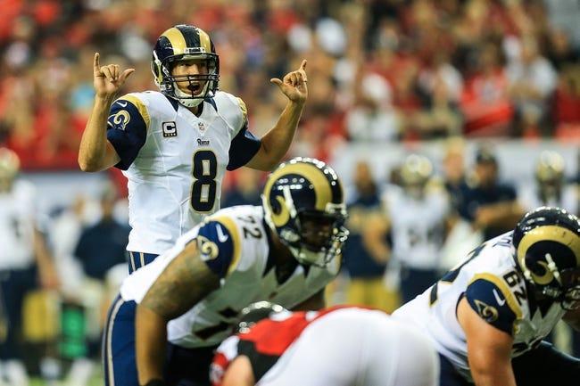 Sep 15, 2013; Atlanta, GA, USA; St. Louis Rams quarterback Sam Bradford (8) calls an audible in the game against the Atlanta Falcons at the Georgia Dome. The Falcons won 31-24. Mandatory Credit: Daniel Shirey-USA TODAY Sports