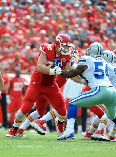 Sep 15, 2013; Kansas City, MO, USA; Kansas City Chiefs offensive tackle Eric Fisher (72) blocks Dallas Cowboys outside linebacker Bruce Carter (54) in the second half at Arrowhead Stadium. Kansas City won the game 17-16. Mandatory Credit: John Rieger-USA TODAY Sports