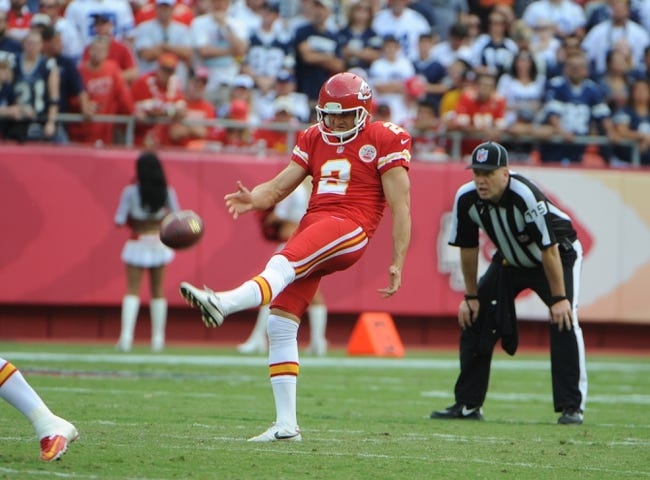 Sep 15, 2013; Kansas City, MO, USA; Kansas City Chiefs punter Dustin Colquitt (2) punts against the Dallas Cowboys in the first half at Arrowhead Stadium. Kansas City won the game 17-16. Mandatory Credit: John Rieger-USA TODAY Sports