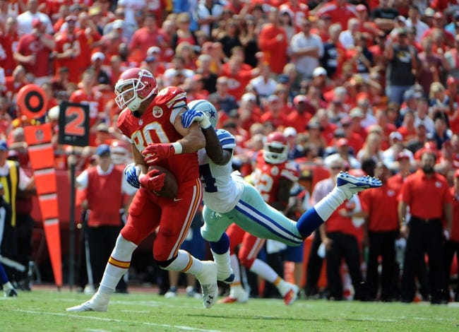 Sep 15, 2013; Kansas City, MO, USA; Kansas City Chiefs tight end Anthony Fasano (80) catches a pass against Dallas Cowboys outside linebacker Bruce Carter (54) in the second half at Arrowhead Stadium. Kansas City won the game 17-16. Mandatory Credit: John Rieger-USA TODAY Sports