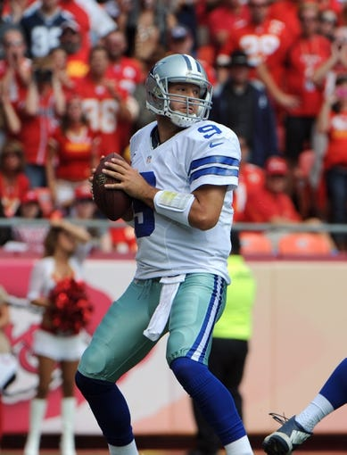 Sep 15, 2013; Kansas City, MO, USA; Dallas Cowboys quarterback Tony Romo (9) looks downfield against the Kansas City Chiefs in the first half at Arrowhead Stadium. Kansas City won the game 17-16. Mandatory Credit: John Rieger-USA TODAY Sports