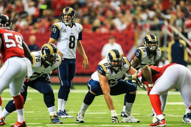 Sep 15, 2013; Atlanta, GA, USA; St. Louis Rams quarterback Sam Bradford (8) in the game against the Atlanta Falcons at the Georgia Dome. The Falcons won 31-24. Mandatory Credit: Daniel Shirey-USA TODAY Sports