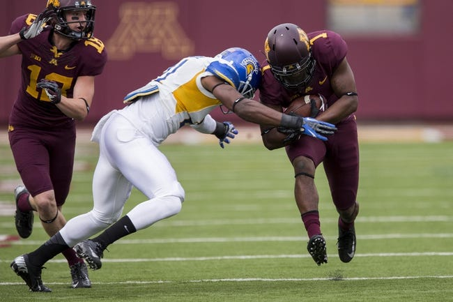 Sep 21, 2013; Minneapolis, MN, USA; San Jose State Spartans cornerback Bene Benwikere (21) tackles Minnesota Golden Gophers wide receiver KJ Maye (1) in the first quarter at TCF Bank Stadium. Mandatory Credit: Jesse Johnson-USA TODAY Sports
