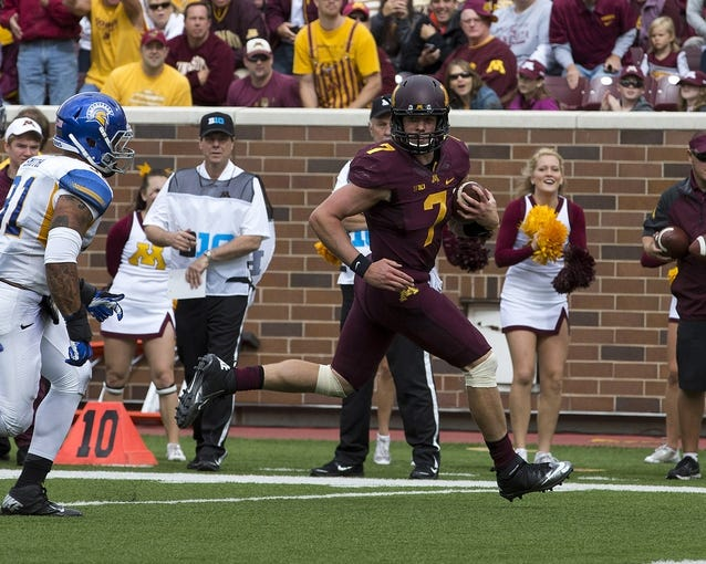 Sep 21, 2013; Minneapolis, MN, USA; Minnesota Golden Gophers quarterback Mitch Leidner (7) runs for a touchdown in the first quarter against the San Jose State Spartans at TCF Bank Stadium. Mandatory Credit: Jesse Johnson-USA TODAY Sports
