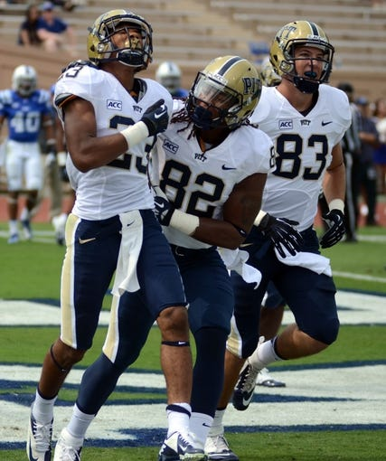 Sep 21, 2013; Durham, NC, USA;  Pitt Panthers receiver Tyler Boyd (23) celebrates a touchdown against the Duke Blue Devils with teammate Manasseh Garner (82) during the first half at Wallace Wade Stadium. Mandatory Credit: Rob Kinnan-USA TODAY Sports