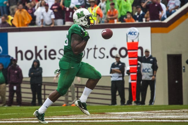 Sep 21, 2013; Blacksburg, VA, USA; Marshall Thundering Herd tight end Gator Hoskins (26) celebrates after scoring a touchdown during the first half against the Virginia Tech Hokies at Lane Stadium. Mandatory Credit: Peter Casey-USA TODAY Sports