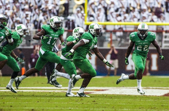 Sep 21, 2013; Blacksburg, VA, USA; Marshall Thundering Herd linebacker Neville Hewitt (43) celebrates his interception during the second half against the Virginia Tech Hokiesat Lane Stadium. Mandatory Credit: Peter Casey-USA TODAY Sports