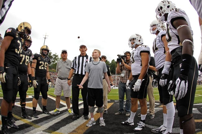 Sep 21, 2013; West Point, NY, USA;  Captains from Army and Wake Forest watch the coin toss before a game at Michie Stadium. Mandatory Credit: Danny Wild-USA TODAY Sports