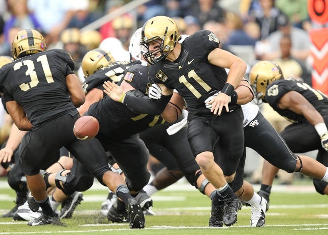 Sep 21, 2013; West Point, NY, USA;  Army Black Knights quarterback A.J. Schurr (11) fumbles the ball during the first half at Michie Stadium. Mandatory Credit: Danny Wild-USA TODAY Sports