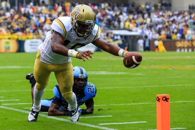 Sep 21, 2013; Atlanta, GA, USA; Georgia Tech Yellow Jackets running back Synjyn Days (10) runs the ball for but is short on the touchdown in the first half against the North Carolina Tar Heels at Bobby Dodd Stadium. Mandatory Credit: Daniel Shirey-USA TODAY Sports