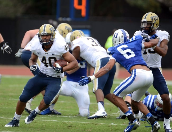 Sep 21, 2013; Durham, NC, USA;  Pitt Panthers running back James Conner (40) runs the ball as Duke Blue Devils cornerback Ross Cockerell (6) defends during the first half at Wallace Wade Stadium. Mandatory Credit: Rob Kinnan-USA TODAY Sports