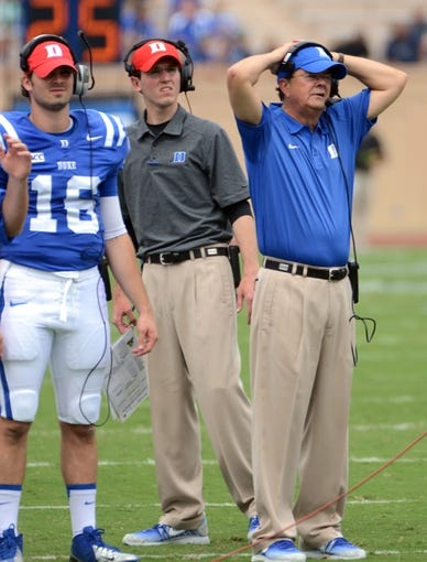 Sep 21, 2013; Durham, NC, USA;  Duke Blue Devils head coach David Cutcliffe (right) watches a replay during the first half against the Pitt Panthers at Wallace Wade Stadium. Mandatory Credit: Rob Kinnan-USA TODAY Sports