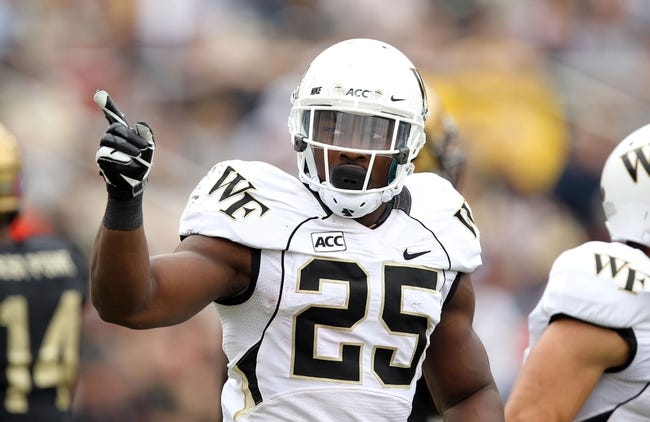 Sep 21, 2013; West Point, NY, USA; Wake Forest Demon Deacons running back Josh Harris (25) celebrates his rushing touchdown during the second half at Michie Stadium. Mandatory Credit: Danny Wild-USA TODAY Sports