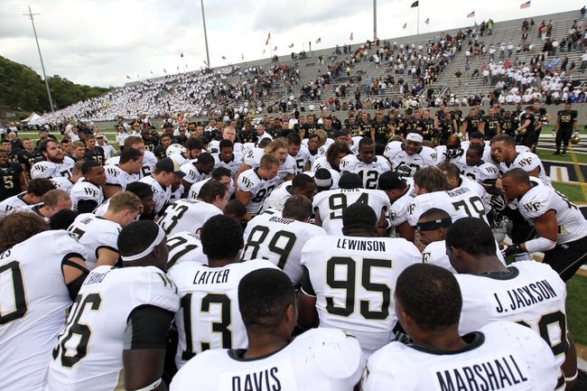 Sep 21, 2013; West Point, NY, USA; Wake Forest Demon Deacons players celebrate after beating the Army Black Knights 25-11 at Michie Stadium. Mandatory Credit: Danny Wild-USA TODAY Sports