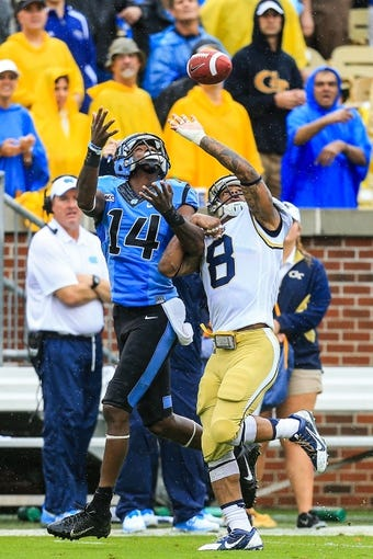 Sep 21, 2013; Atlanta, GA, USA; Georgia Tech Yellow Jackets cornerback Louis Young (8) breaks up a pass intended for North Carolina Tar Heels wide receiver Quinshad Davis (14) in the second half  at Bobby Dodd Stadium. Georgia Tech won 28-20. Mandatory Credit: Daniel Shirey-USA TODAY Sports